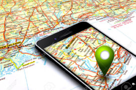 22685551-mobile-phone-with-gps-laying-on-map-stock-photo